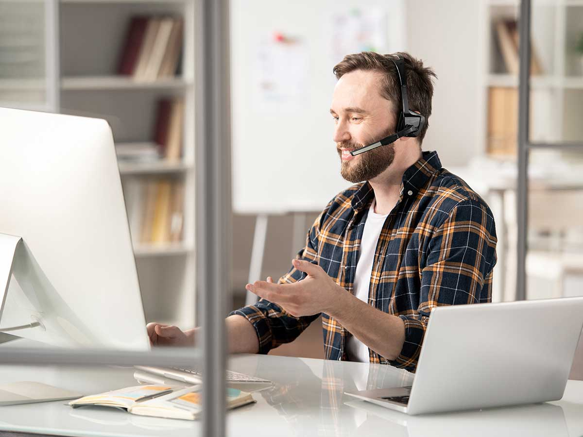 man using headset talking about the future of telephony