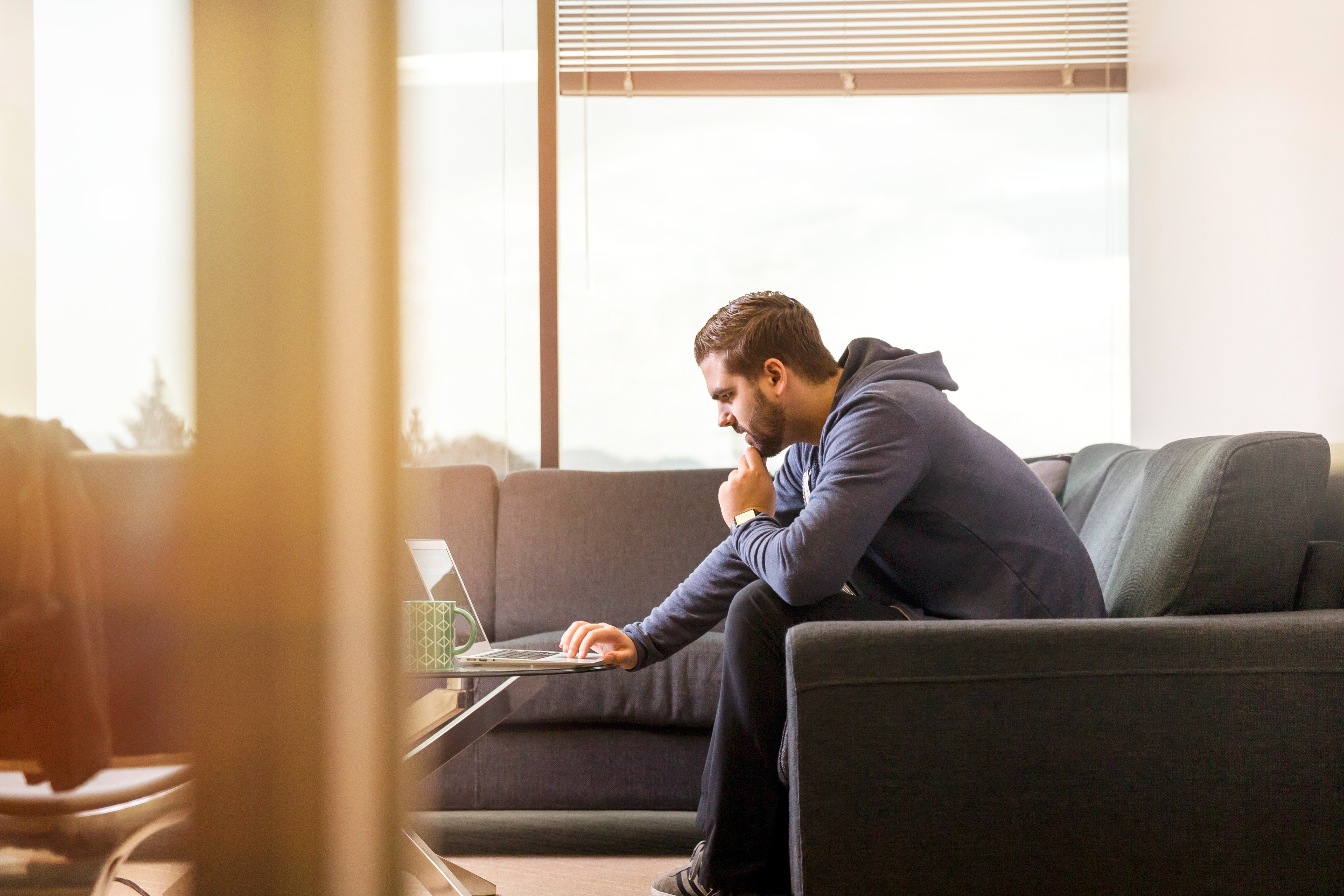 man using laptop because remote work is on the rise