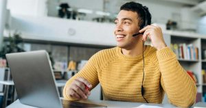 male using headset on laptop