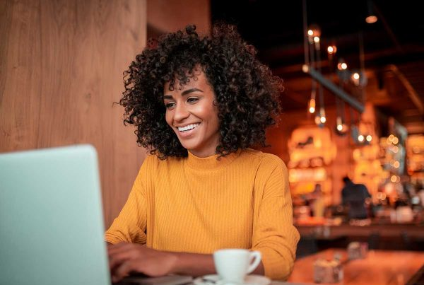 woman communicating on laptop in coffee shop