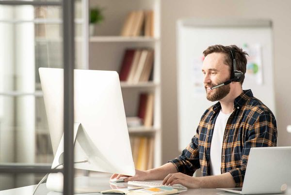 man looking at crm trends on pc